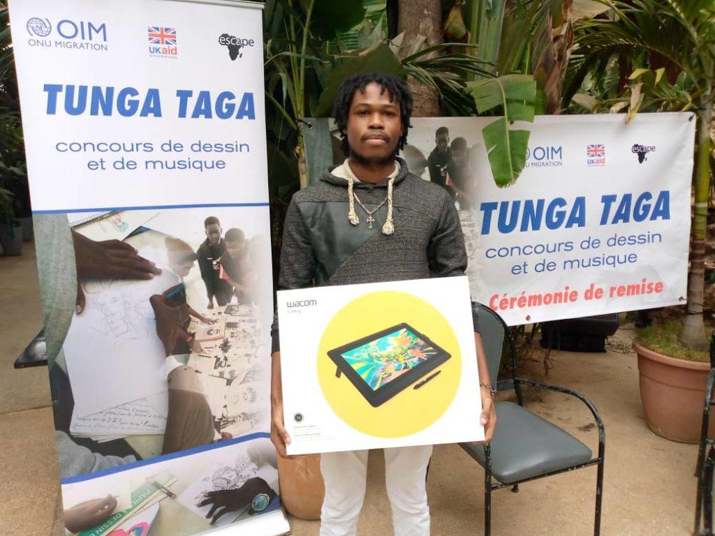 Sénégal – Christ Alan Gauthé remporte le concours de dessin de  l'OIM ( Tunga Taga)